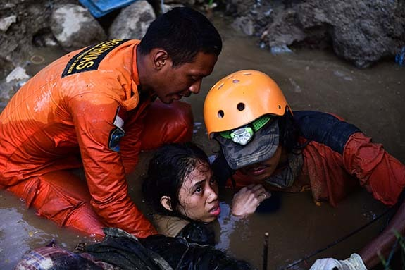 Nurul (15) spent nearly 48 hours trapped in the ruins of her own home, partially submerged under water, 30 September, Central Sulawesi, Indonesia.